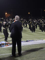 Abilene High School band director Paul Walker watches