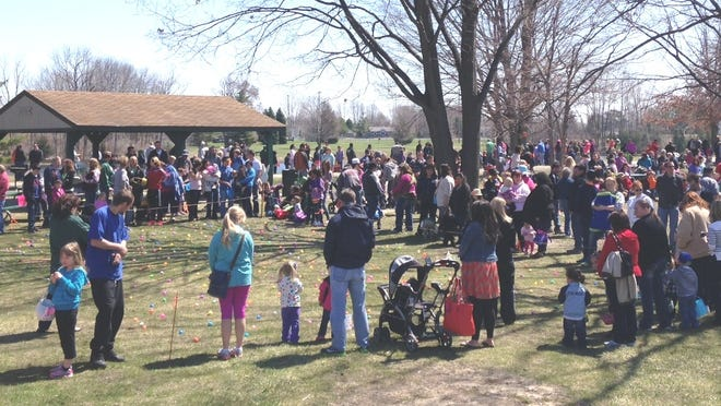 Dozens of youngsters get ready to go after hundreds Easter eggs in April 2014 at Valhalla Park in Delhi Township.