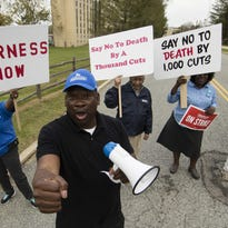 Faculty member Angela Florschuetz, center, her colleagues, and their supporters picket at Cheyney University in Cheyney, Pa., Thursday, Oct. 20, 2016. Faculty at Pennsylvania state universities continue their strike that started Wednesday morning, disrupting classes midsemester after contract negotiations hit an impasse. (AP Photo/Matt Rourke)