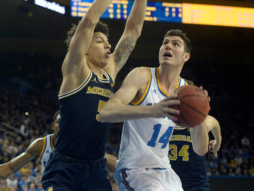 UCLA forward Gyorgy Goloman (14) moves to the basket