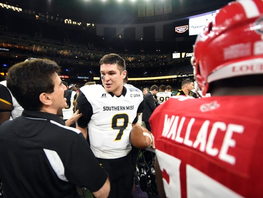Southern Miss quarterback Nick Mullens is congratulated
