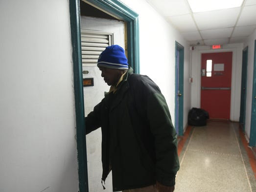 John Sam Hall, 67, walks the fifth floor to his shared