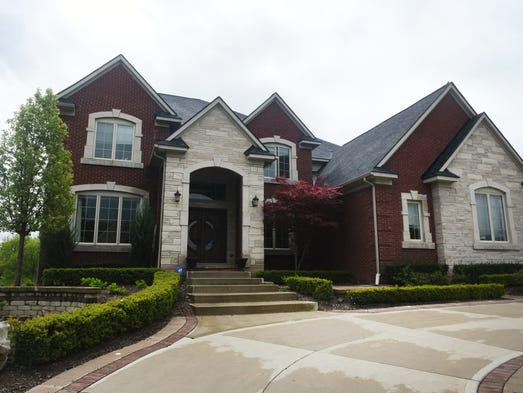 The handsome exterior of this Northville home leads