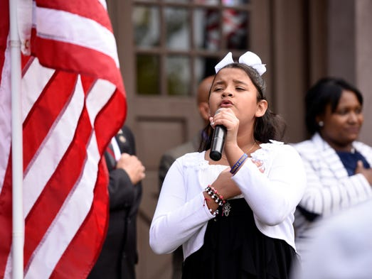 Michelle Galvis, 11 of Hackensack, sings the National