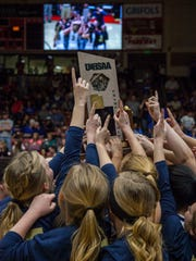 Snow Canyon celebrates winning the 3A championship game against Cedar in the SUU Centrum, Feb. 27, 2016.