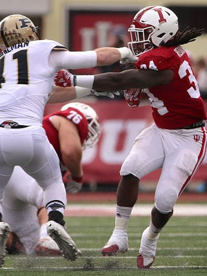 Indiana Hoosiers running back Devine Redding (34) fights off Purdue Boilermakers safety Jacob Thieneman (41) during first half action of the Oaken Bucket game between Indiana and Purdue at Memorial Stadium, Bloomington, Ind., Saturday, Nov. 26, 2016.