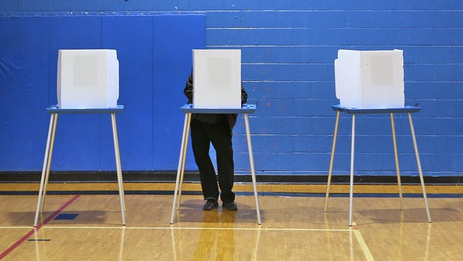 A voter cast his ballot at the Douglass Park Community Center on Election Day, Nov. 4, 2014.