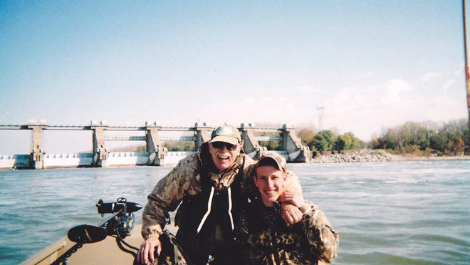 Abdul-Rahman Kassig fishing with his father, Ed Kassig, near the Cannelton Dam on the Ohio River in southern Indiana in 2011. Photo provided by the Kassig family.