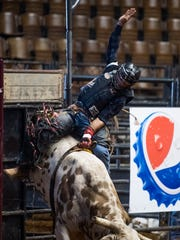 Wagner Luciano bull riding during the SLE Rodeo matinee