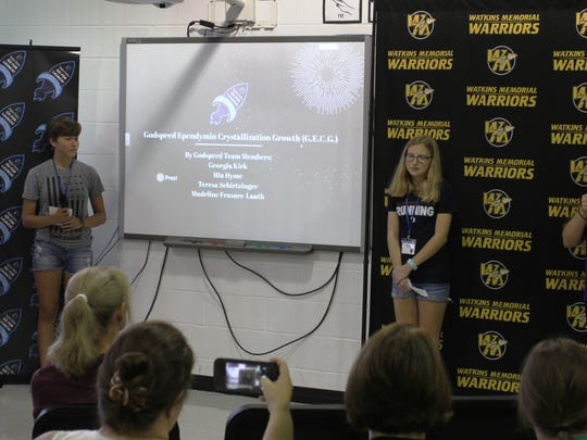 A team featuring a student from Olentangy, Teresa Schirtzinger, and three incoming freshmen at Watkins Memorial, Mia Hyme, Georgia Kirk and Madeline Frasure-Lauth, was named the winning squad at the STEM-centric summer camp. Here, they give their presentation.