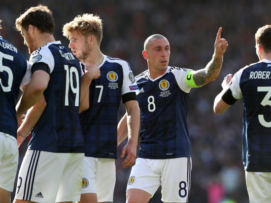 Scotland S Team Captain Scott Brown Gestures During The World Cup Group F Qualifying Soccer Match Between