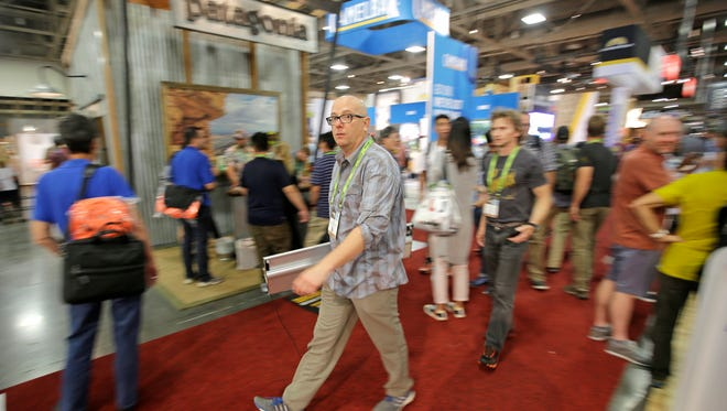 People attend the Outdoor Retailer show Friday, Aug. 5, 2016, in Salt Lake City. Thousands of people are expected in Salt Lake City this week to take part in the world's largest outdoor retail show that comes twice a year to Utah. The Outdoor Retailer show allows store owners to meet with manufacturers and suppliers to preview new products. (AP Photo/Rick Bowmer)