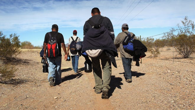 File photo of undocumented immigrants walking through the Sonoran Desert after crossing the U.S.-Mexico border in 2011.