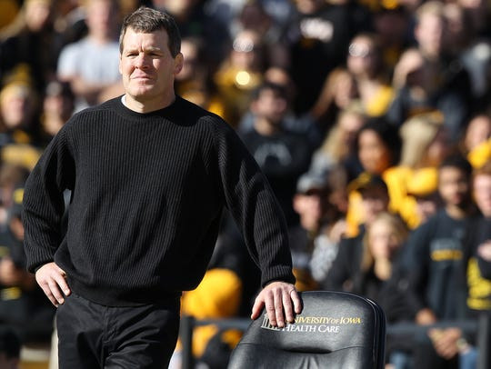 Iowa head coach Tom Brands watches during the outdoor