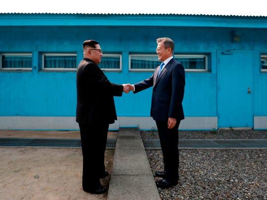 North Korea's Kim Jong Un , left, and South Korea's Moon Jae-in meet in late April.