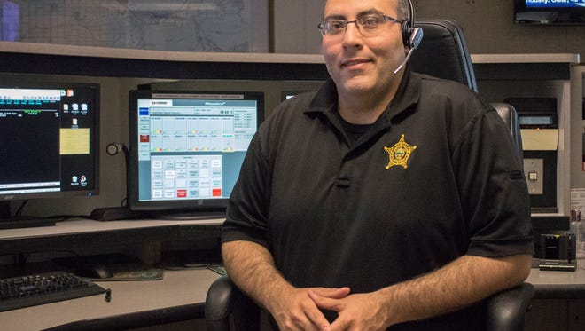 John Knecht, dispatcher at the Ottawa County Sheriff's Office, was honored as the Telecommunicator of the Year by the Ohio Gold Star Awards Program for his work handling a call from an abducted woman.