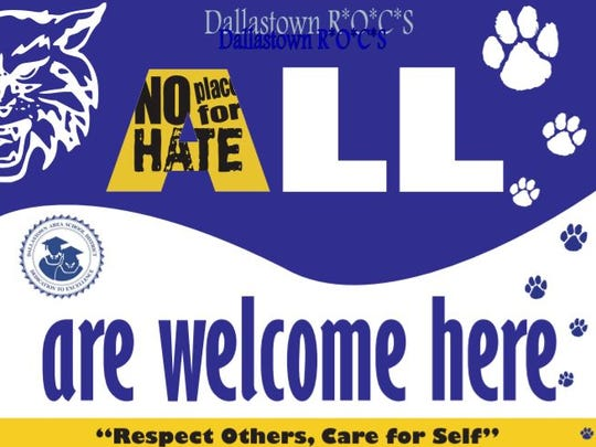 "Dallastown Area School District created this sign to replace a rainbow ""All Are Welcome Here"" poster that the district is no longer allowing in schools."