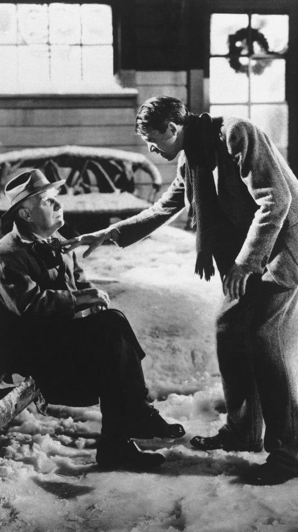 Henry Travers as Clarence the Angel, left, and James