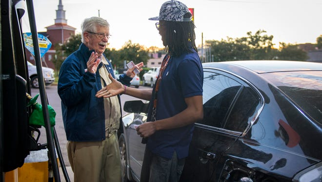 """""""You do the cartoons in the paper!"""" exclaims Trey Blevins, right, as Knoxville News Sentinel editorial cartoonist Charlie Daniel, left, introduces himself and hands out free drink coupons and pumps gas at the Pilot gas station on Western Ave. on Monday, Oct. 2, 2017. Daniel is part of Pilot Celebrity Pumpers, where Knoxville celebrities help pump gas in support of Pilot's fundraising efforts for the United Way."""