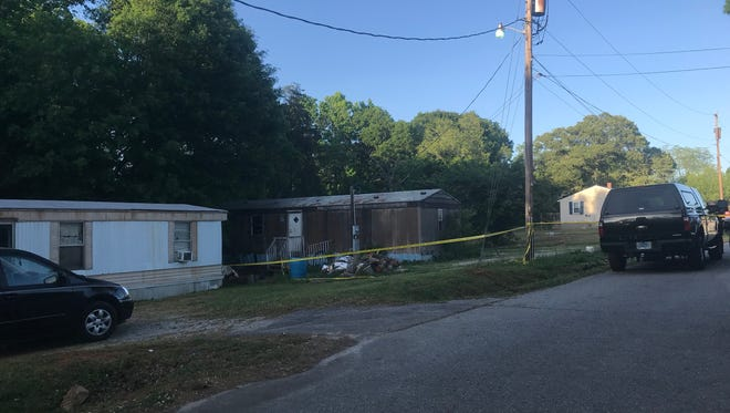 Investigators look at a mobile home on Overbrook Street as part of their investigation of a double homicide that was discovered Sunday, May 6, 2017.