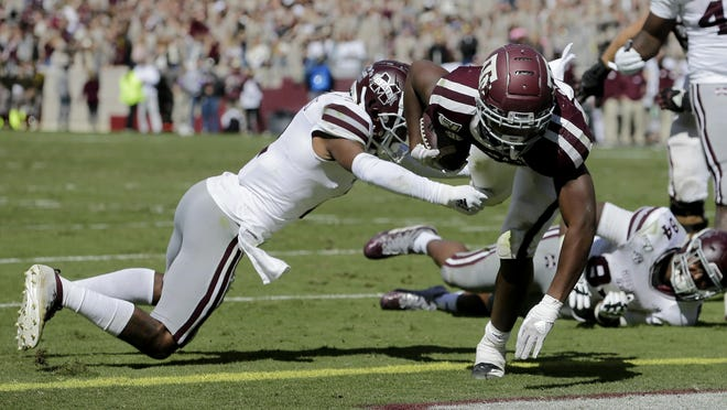 Texas A&M running back Isaiah Spiller (28) bounces off a tackle attempt from Mississippi State cornerback Jarrian Jones (2) as he crosses the goal line for a touchdown during a game Oct. 26, 2019, in College Station, Texas. According to a database published Thursday in USA TODAY, Texas A&M led Southeastern Conference schools for fiscal year 2018-19 in total operating revenue and total operating surplus. Vanderbilt, the lone private university in the SEC, was not included.