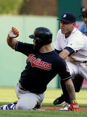 Indians first baseman Mike Napoli, left, is tagged out by Tigers second baseman Ian Kinsler during the second inning Cleveland