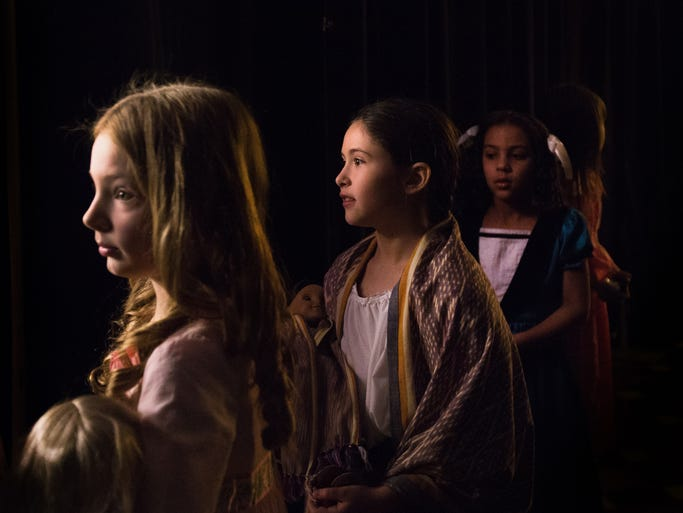 Ellery Underhill, left, Meg Macauley, center, and Gracynn Burns, right, wait back stage as they prepare to walk the runway at the American Girl Fashion Show at the Chase Center in Wilmington on Sunday afternoon, March 9, 2014.
