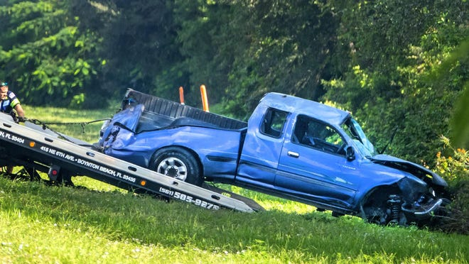 A pickup involved in a fatal crash is towed from the bushes alongside I-95 after a single-vehicle accident in which the driver died when he was ejected from the truck Friday, Jan. 3, 2020.