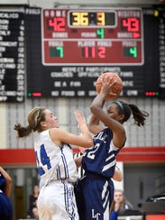 Cocalico's Lyndsay Engle defends against a jump shot