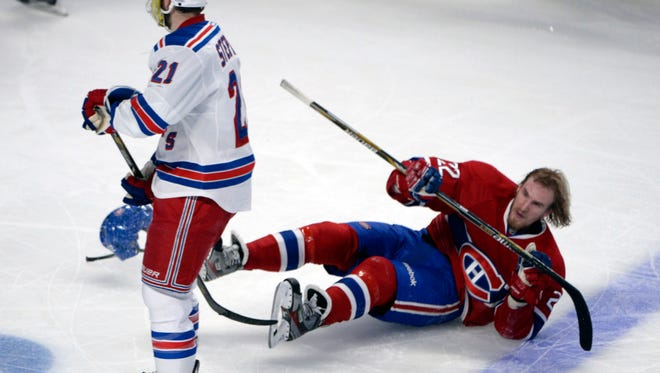 Rangers forward Derek Stepan skates by Montreal forward Dale Weise after the hit by teammate John Moore (not pictured) during the third period of Game 5 of the Eastern Conference final Tuesday night.