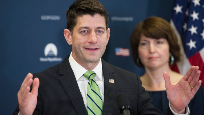 House Speaker Paul Ryan of Wis., accompanied by Rep. Cathy McMorris Rodgers, R-Wash., speaks to reporters on Capitol Hill in Washington.