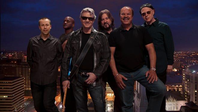 The Steve Miller Band: Jacob Petersen (rhythm guitarist/vocals) left; Joseph Wooten (keys and vocals); Steve Miller (lead guitar/lead vocals); Kenny Lee Lewis (bass/vocals); Sonny Charles (vocals) and Gordy Knudtson (drums).