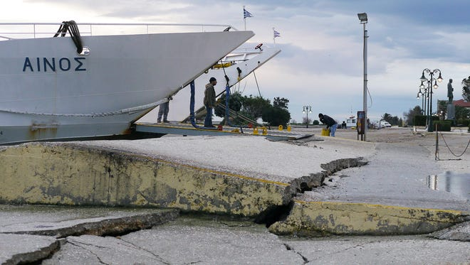 Cracks appear on the quayside of the port of Kefalonia after an earthquake hit the island early Monday.