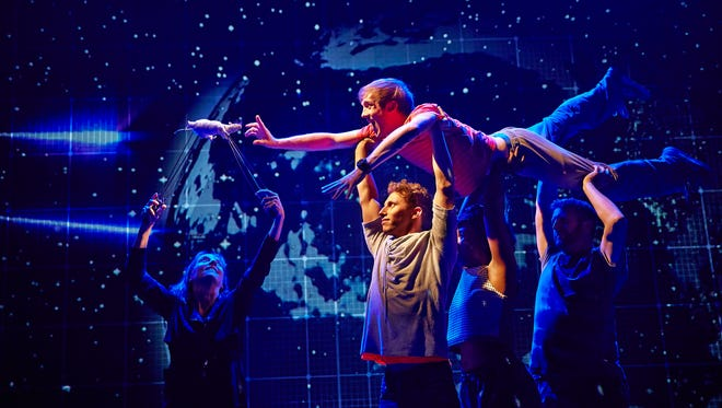 """This image released by Boneau/Bryan-Brown shows the cast during a performance of """"The Curious Incident of the Dog in the Night-Time,"""" in London."""