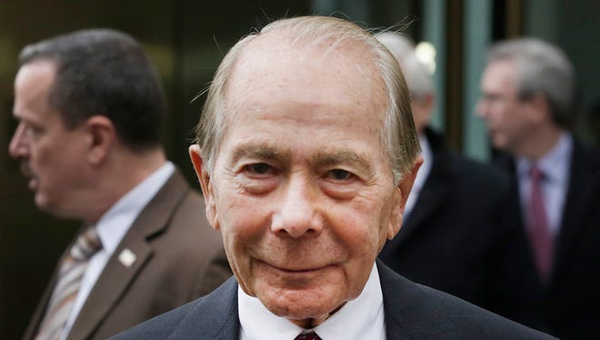 "File photo taken in 2014 shows former AIG CEO Maurice ""Hank"" Greenberg, leaving the insurance company's headquarters."