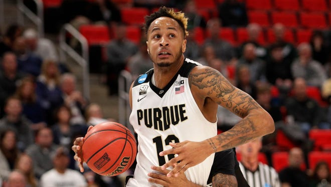 Purdue Boilermakers forward Vincent Edwards (12) looks to make a play defended by Butler Bulldogs guard Henry Baddley (20) in the second round of the 2018 NCAA Tournament at Little Caesars Arena.