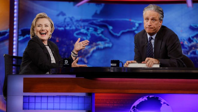 Hillary Clinton reacts to a quip by Jon Stewart, who is signing off 'The Daily Show' by year's end.