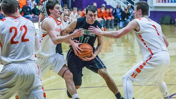 Yorktown's Riley Miller struggles against Hamilton Heights' defense during their game at the Muncie Fieldhouse Saturday evening.