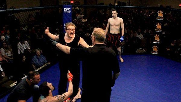 A mother rushes into the ring after her son is knocked out in a mixed martial arts bout in Columbus, Ohio.