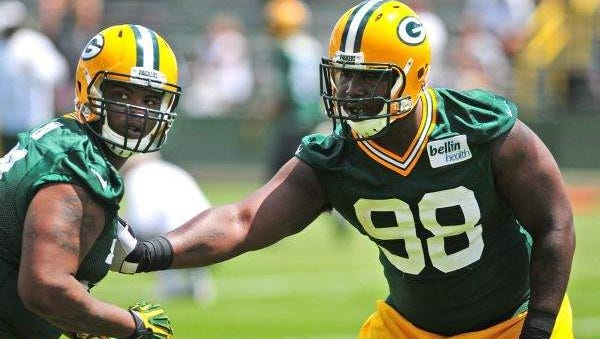 Defensive tackle Letroy Guion works with defensive end Carlos Gray during OTA practice June 3 at Ray Nitschke Field in Ashwaubenon. H. Marc Larson/Press-Gazette Media