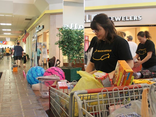 Jessica Malone, APS health assistant, works on organizing non-perishable food donations for LOVE Inc.