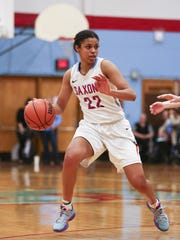 South Salem junior Evina Westbrook (22) looks for a way around McMinnville senior Elizabeth Logsdon (14) in Salem on Friday, Jan. 8, 2016.