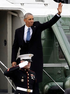 Former president Barack Obama waves as he boards a Marine helicopter on the East Front of the Capitol on Friday, Jan. 20, 2017, in Washington, after Donald Trump was inaugurated. Obama and his family are heading to Palm Springs for vacation Friday.