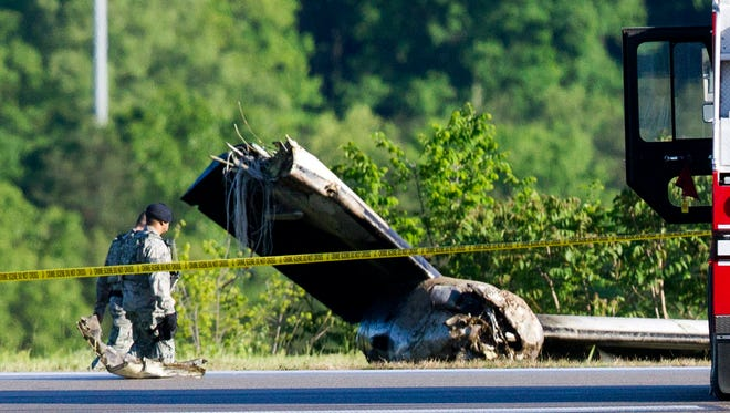 Part of a cargo plane lies on the ground after a fatal crash Friday at Yeager Airport in Charleston, W. Va. The plane contracted by UPS went off the runway and over a hillside at the West Virginia airport Friday morning, an airport official said.