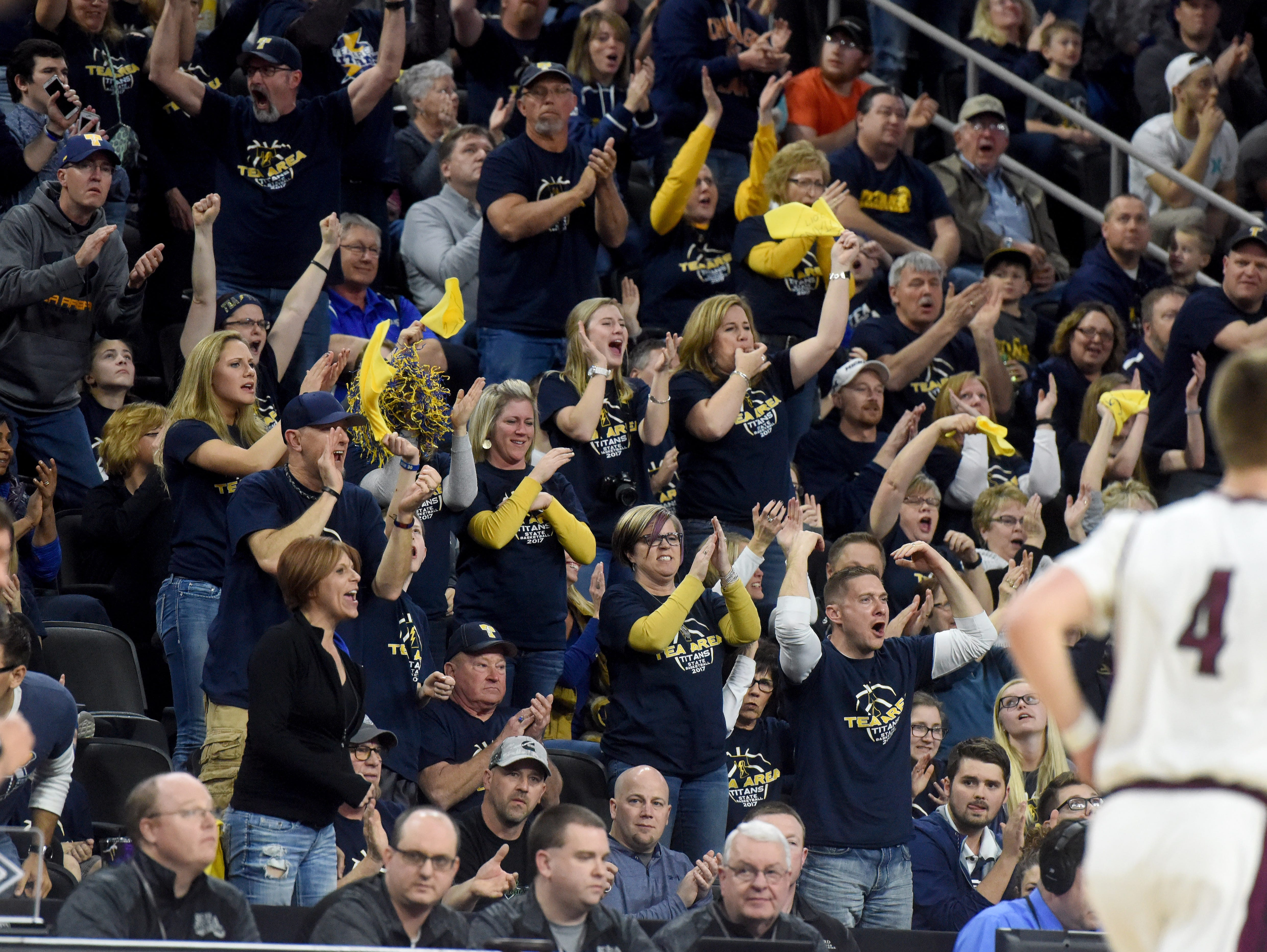 Tea Area fans go wild after scoring against Madison during the 2017 SDHSAA Class A boy's basketball championship at the Denny Sanford Premier Center on Saturday, March 18, 2017.