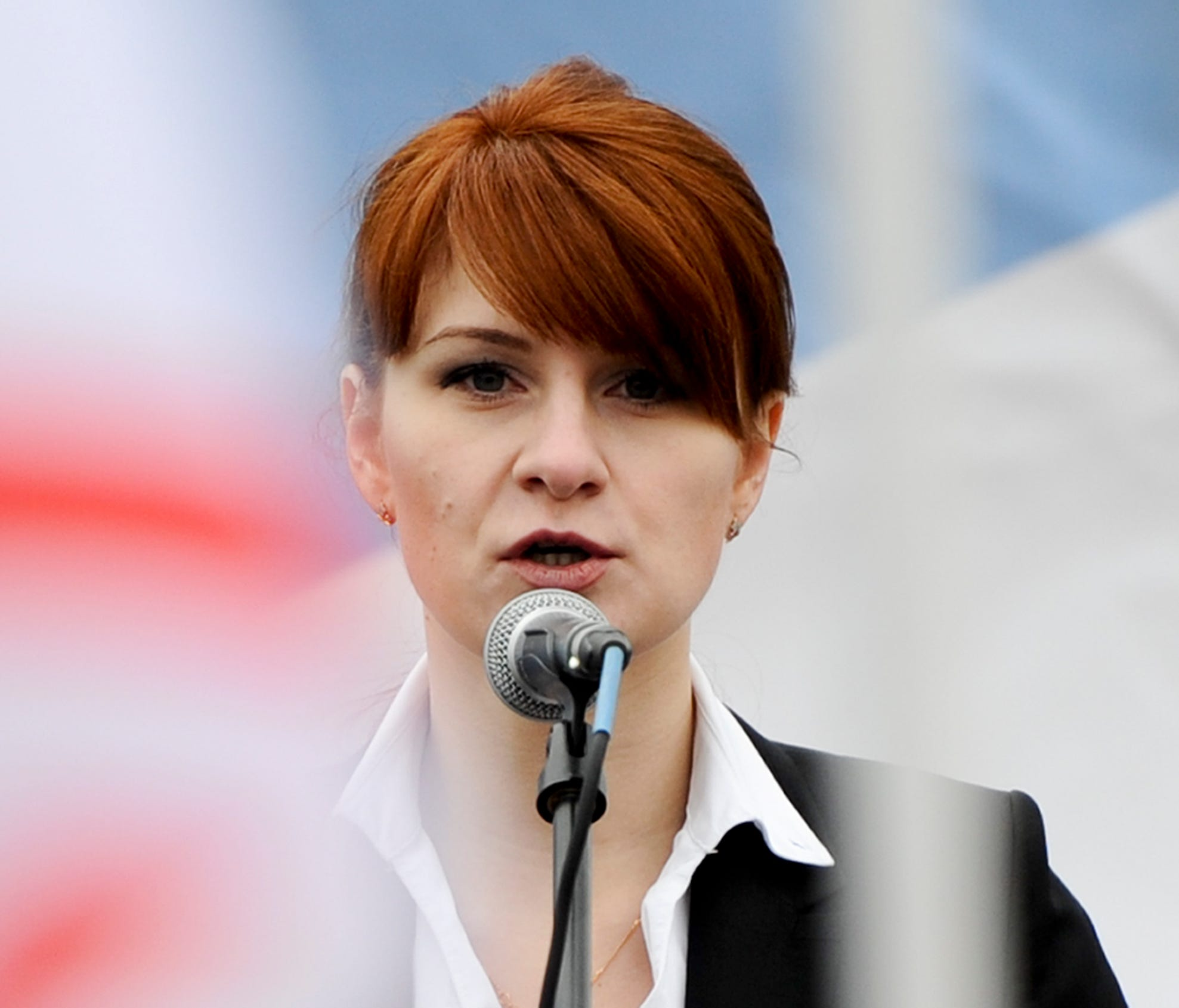 In this photo taken on Sunday, April 21, 2013, Maria Butina, leader of a pro-gun organization in Russia, speaks to a crowd during a rally in support of legalizing the possession of handguns in Moscow, Russia. Butina, a 29-year-old gun-rights activist