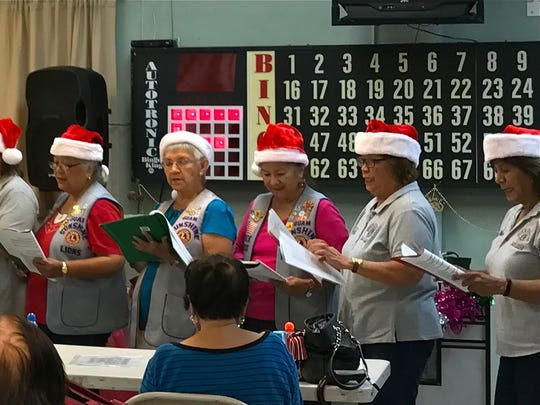 "In keeping with the club's mission of ""Caring for the Sick and the Elderly, members of the Guam Sunshine Lions Club brought treats, cheer, and song to the seniors at the Agat center on Dec. 14. Singing Christmas carols from left: Lions Pete Babauta, Dee Cruz, Marietta Camacho, Lola Flores, Dot Leon Guerrero, Connie Rivera, Clarice Quichocho, Lorraine Rivera (partly hidden), Clare Cruz, Danny Cruz, Julie Cruz, Helen Colby, Helen Mendiola, Bobbie Flores, Jill Pangelinan, and Mary Taitano."
