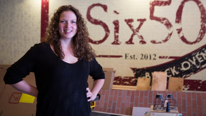 Ilana Stevenson, the general manager at Six50 Restaurant, poses for a portrait inside their new location in Victor on Friday, September 25, 2015. Their other location in Chili burned down after an accidental fire earlier this month.
