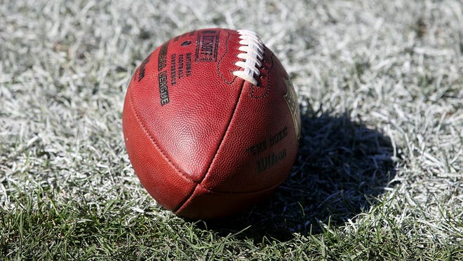 A football rests on the ground during a game between the Detroit Lions and Chicago Bears.