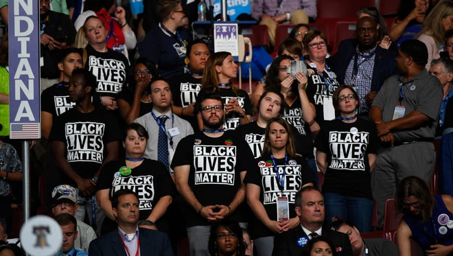 A group of people wear Black Lives Matter t-shirts.